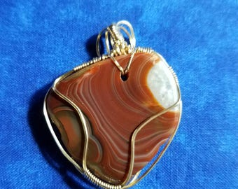 Lake Superior Agate wrapped in 22G 12 Ct Gold