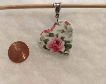 Lovely roses on a heart shaped broken china pendant