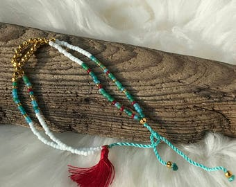 Turquoise and white friendship bracelet with gold accent and tassel