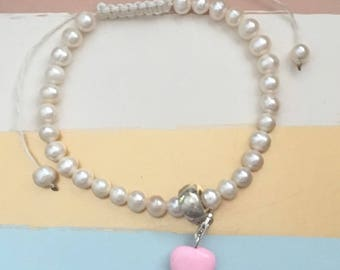 Pearl look bead bracelet with pink heart charm