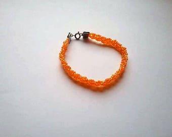 orange braided bracelet