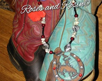 Saddle bronc necklace