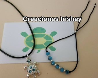 Necklace with turtle and adjustable bracelet