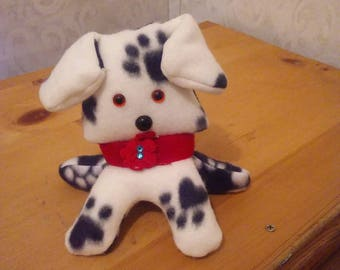 Puppy in fleece black and white paw print. Hypoallergenic stuffing. Safety eyes n nose. Felt tongue n collar. Measures 6 high.
