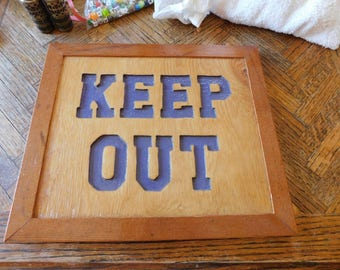 Handmade (KEEP OUT) sign made on reclaimed wood