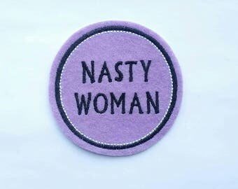 Nasty woman embroidered felt patch applique in lilac felt with black and white embroidery thread