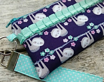Cute sloth wristlet. Blue fabric sloths. Check register holder, credit cards. Date night clutch. With detachable key fob. Keychain ID wallet