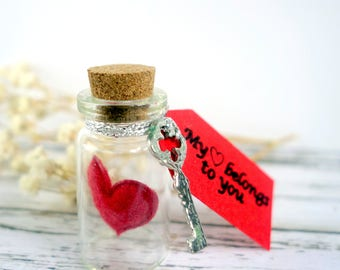 Alternative Valentine/anniversary gift/keepsake. Miniature glass bottle with red heart, silver key and message: My heart belongs to you