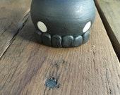Porcelain skull salt shaker in black lava, Handthrown