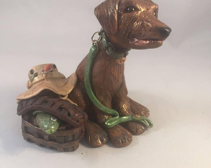 Gone Fishing Dog Sculpture