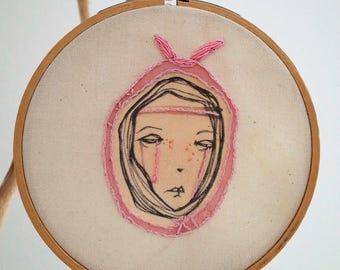 Sad rabbit girl, an embroidered drawing