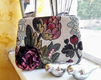 Purple floral clutch bag