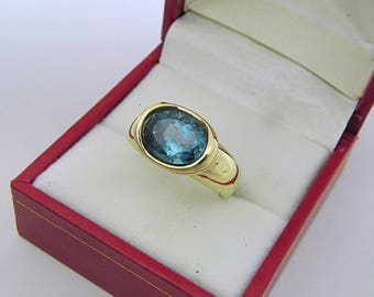 AAAA London Blue Topaz  3.31 carats  9.9x8mm in 14K Yellow gold bezel set ring.  0253