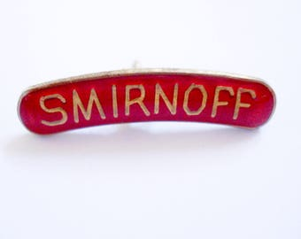 FOUND IN SPAIN -- vintage pin - Smirnoff vodka logo