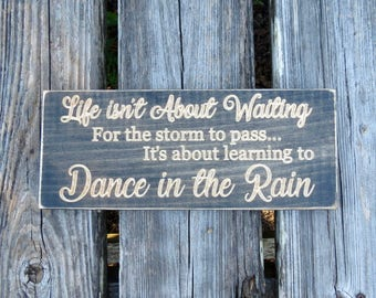 life isn't about waiting for the storm to pass sign,gift,dance,learn to dance,dance in the rain,wood sign,dance in the rain sign,typography