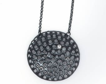 Large perforated sterling silver pendant, oxidized black, cubic zirconia, 17 inch chain.