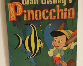 1939 Walt Disney Pinocchio stiff soft cover picture reading book.