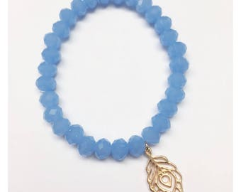 Sky Blue 5mm Faceted Crystal Bead Bracelet with Gold Peacock Feather Charm