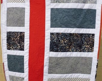 Gray and white crib or lap quilt, with a red vertical stripe