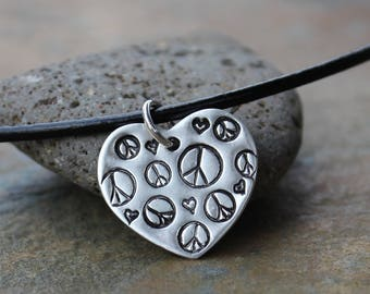 Peace Love necklace - handmade fine silver heart charm with tiny peace symbols and hearts on black leather cord -  free shipping USA