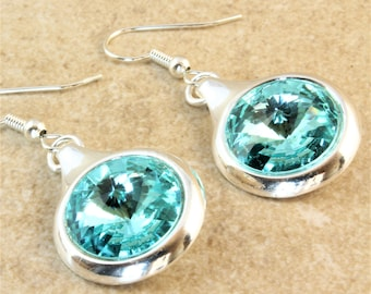 Swarovski Light Turquoise Rivoli Crystal in a Silver Plated Round Setting on Silver Plated Ear Wire