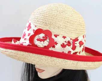 Raffia Straw wide brim straw sun hat with Canada Day red trim and belt loops and adjustable fit