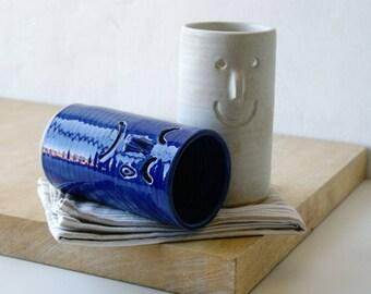 Ceramic pair of vases with face design - glazed in vanilla cream and ocean blue