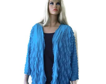 Sea blue Blue Jacket cardigan with cascading ruffles .It  fits from Small to X-Large,Dress up or down-lightweight
