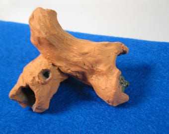 small terra cotta sculpture turtle in a hollow log nature art accessory collectable