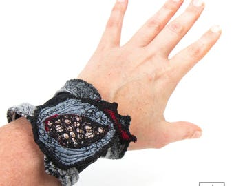 Woman Bracelet. Felted textile art in black, gray with dots. One of a kind  stretchy Textile Cuff Jewelry Felt & Embroidery. Made in Paris