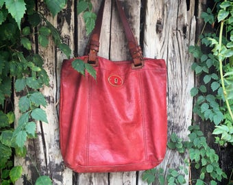 Vintage soft red leather Fossil shoulder bag with brown leather and canvas straps bohemian tote