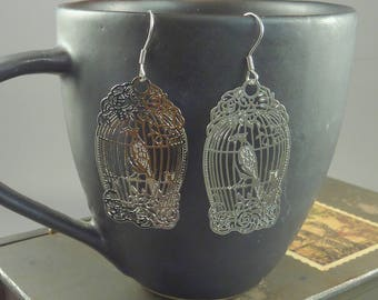 Rocking Bird. Silver Birdcage Earrings. statement earrings. silver earrings. chandelier earrings. romantic earrings. bird earrings.