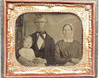 Tin type of a family with half the case