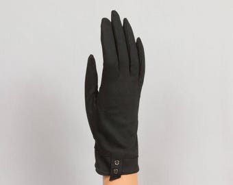 1960s Black gloves Cuff is cut at an angle Decorated cuff Placket on the palm Sz Small - medium, Excellent condition Pristine