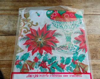 CHRISTMAS. TABLECLOTH. 1960s. Kids Tablecloth. plastic. large 52 x 90 inches. Candles. Poinsettias. Ornaments. deadstock. New in Package.