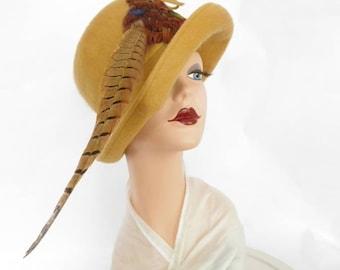 Vintage 1960s hat, cloche tilt with pheasant feather