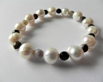 Freshwater cultured pearl and tourmaline stretch gemstone bracelet.