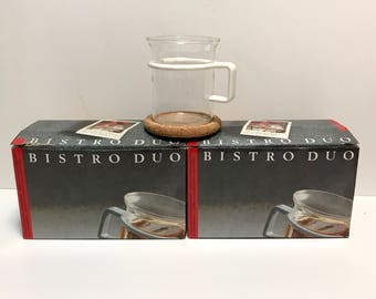 Vintage 1980s BODUM Bistro Duo Glass Coffee Tea Cups, four glass cups with white plastic handles and cork coasters, original boxes