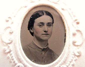 antique tintype with paper frame - young woman, rosy cheeks