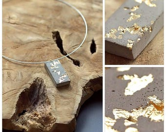 Concrete pendant with gold