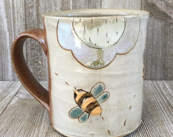 Mug with Three Bees and Two Flowers