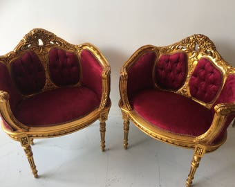 Antique gilded red tufted chairs. Interior design. Fig House Vintage