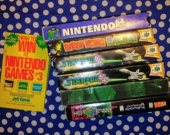 Nintendo 64 promotional VHS lot with NES guide book