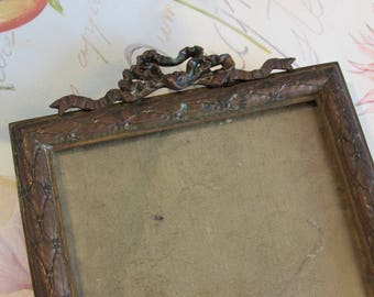 Antique French adorable ormolu metal photo frame with bow.