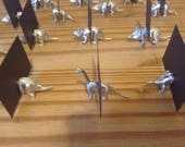 120 Dinosaur place card holders in gold