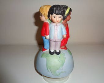 WE ARE The WORLD Musical Playing Ceramic Figurine with Children from across the universe standing on our planet as they go around and around