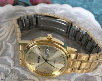 Vintage Gold Mans Watch. Lorus LR0211 Calendar Watch 100 Feet/30 Meters Water Resistant, With Second Hand. Gold Mans Watch.