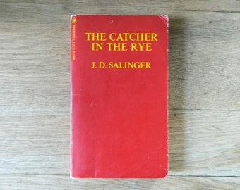The Catcher in the Rye by J.D. Salinger. vintage paperback.