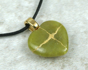 Broken heart pendant in green stone with gold kintsugi (kintsukuroi) style repair on cotton cord - OOAK