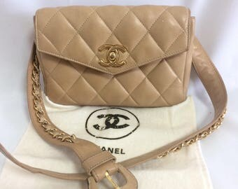 "Vintage CHANEL beige lambskin waist purse, fanny pack, hip bag with gold CC closure and chain belt. 28"", 29.5"", and 30.5"". 72cm, 75cm, 78cm"